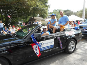 David Bulluck and his wife ride along in the July 4th parade