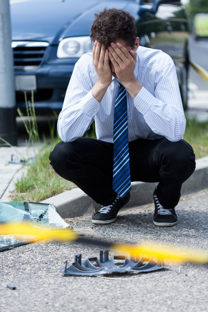 Elegant man crying at accident scene, vertical